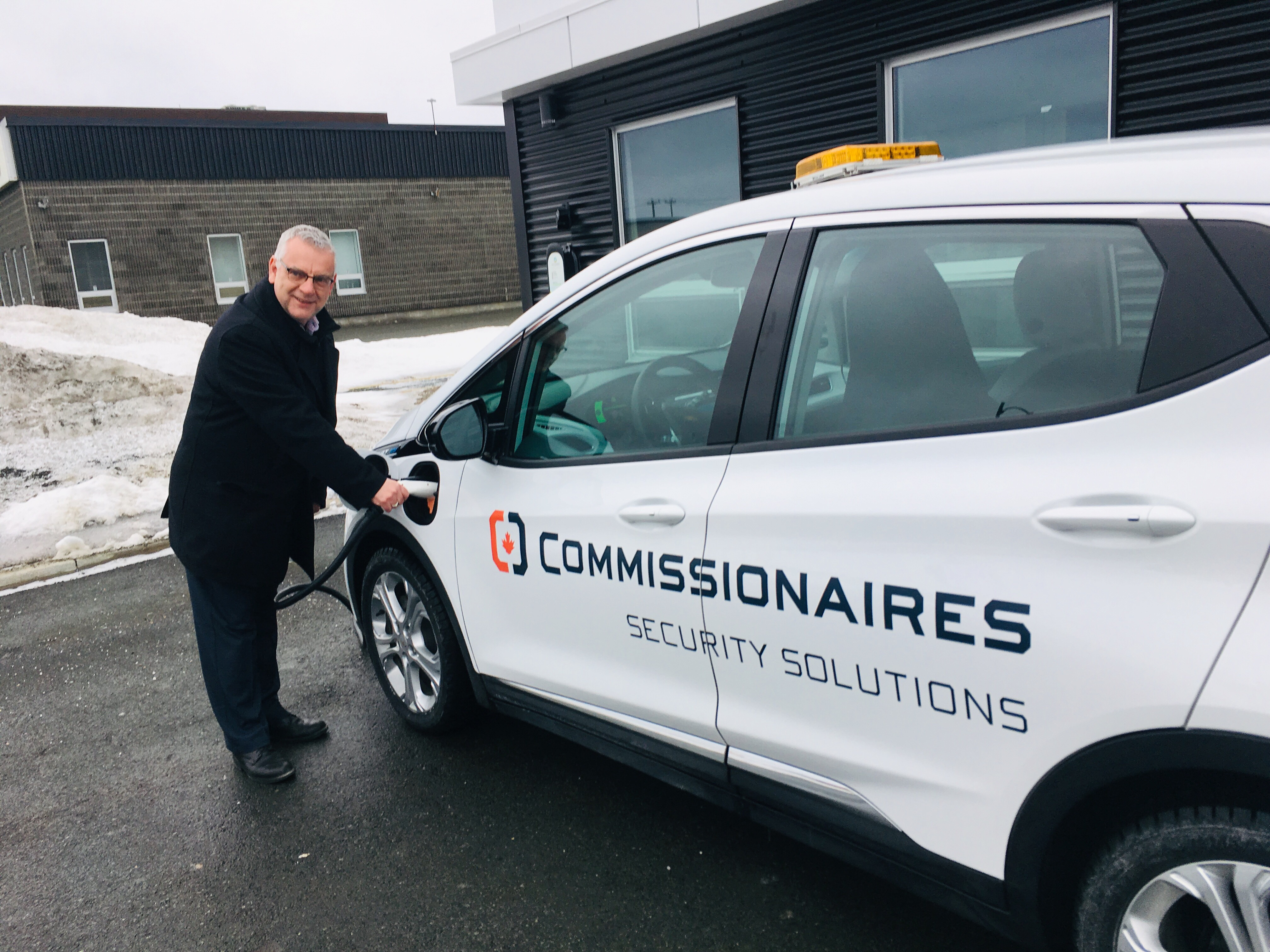 St. John's Mayor Danny Breen charging the new car