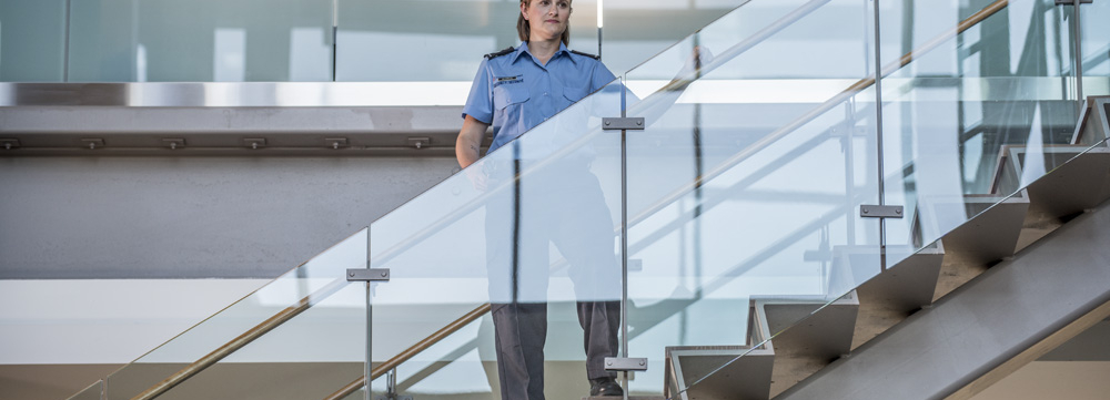 woman commissionaire on staircase