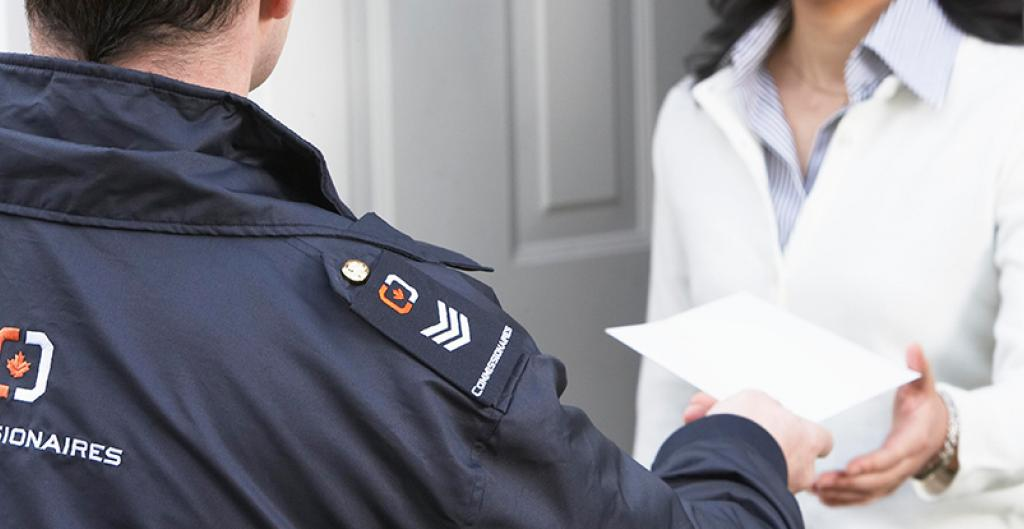 An officer serving a document to an individual